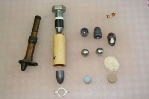 Bullets and components used to test a .69-caliber Minie ball with an expanded base in the .75-caliber Brunswick rifle.