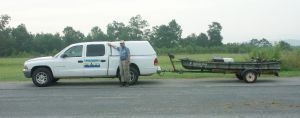 Author with Bondo Boat and Weldo Trailer before starting off on a cross-country bowfishing trip.