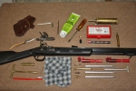 Traditions PA Pellet rifle with accessories.