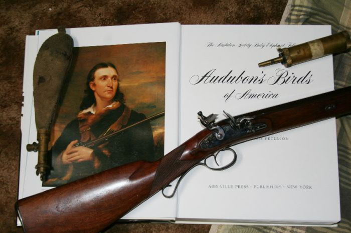 John James Audubon with his double-barreled flintlock shotgun as shown in the American Audubon's Baby Elephant collection of his prints. My single-barreled fowler and accessories are as technically close as I could come to hunting some of the same birds that Audubon did with a period-correct firearm.