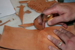 Field's Hybrid leather knife used here for cutting a thick piece of cow leather.