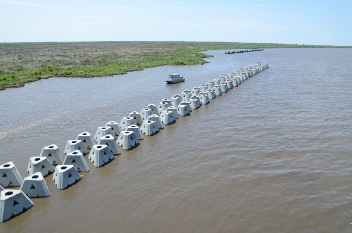 Living Shoreline Solutions' WAD barriers being emplaced to protect a portion of Louisiana's offshore wetlands.