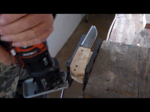 Rough cutting the grips to shape with a skill saw.