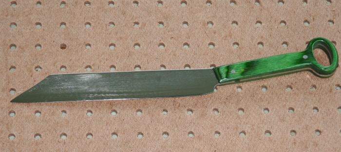 Long handled slicer on pegboard